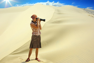 Woman on the background of the dune.