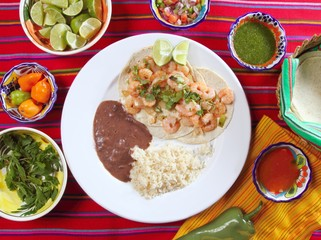 shrimp tacos rice and frijoles chili sauces Mexican