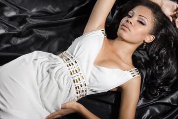 fashionable mulatto woman in white dress