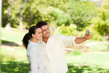 Young couple taking a photo of themselve