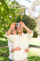 Couple taking a photo of themselve