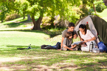 Fototapeten Camping Joyful family camping in the park