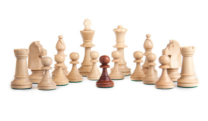 A little black pawn facing the white enemy