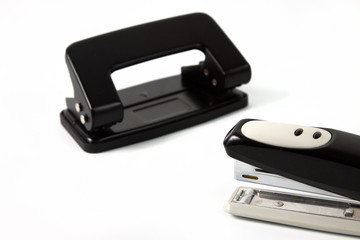 office hole punch and staplers isolated in white