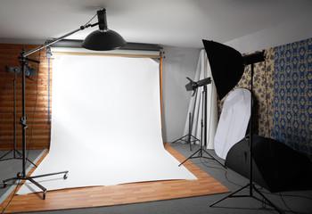 White background inside studio - dark room lighted big lamps