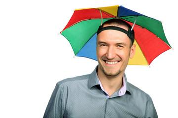 Portrait of  happy businessman with rainbow hat umbrella on head