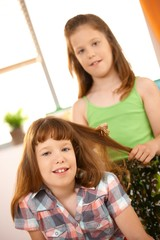 Little girls playing with hair style
