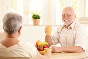Portrait of senior man at breakfast