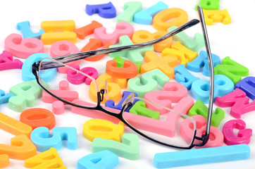 Eyeglasses and letters