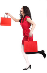 Beautiful woman with red dress and red shopping bags