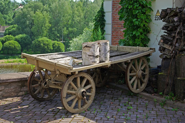 Cart in a country house court yard