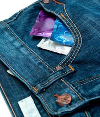 condom in jeans over white