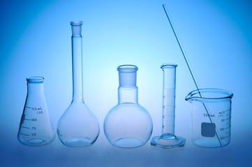 Laboratory glassware on blue background