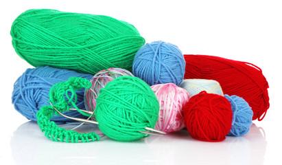Knitting yarn and  knitting needles on white