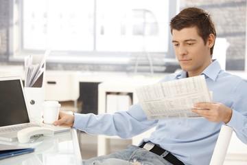 Businessman taking break in office