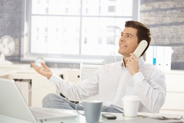 Businessman in office on phone call