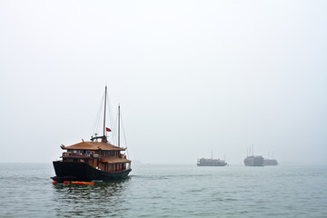 Boats heading off to work in a cloudy day