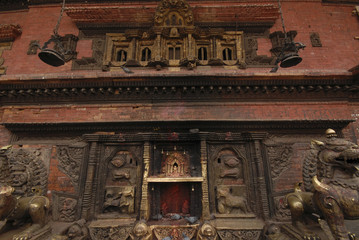 Bronze Goddess at wall in Hindu temple 1.