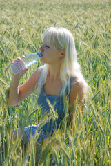 Blond woman in field
