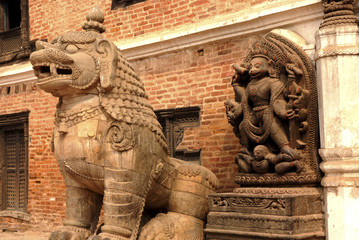 Stone Goddess an d Guardian lion in Hindu temple.
