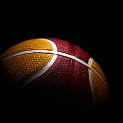 Close-up of a basketball isolated on black background