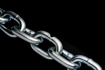 closeup of steel chain links with weak link