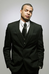 Young businessman in a black suit.