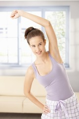 Happy woman exercising in morning
