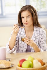 Smiling woman having cereal