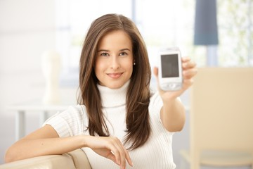 Portrait of woman holding cellphone