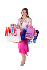 Beautiful woman with shopping bags over white