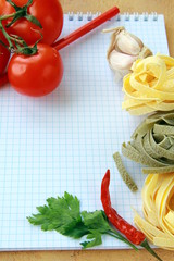 notebook with  pasta  and vegetables for a menu