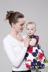 Charming mother holding her charming dauther