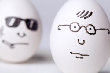 Cute egg in glasses with smiking egg in sunglasses