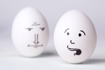 Seniour manager egg looking at  unhappy manager egg