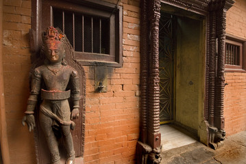 Stone Deity  front of temple at Patan Durbar Square, Nepal.1.