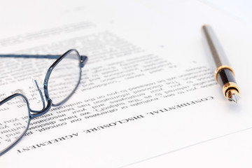 Pen and Spectacles with Disclosure Agreement