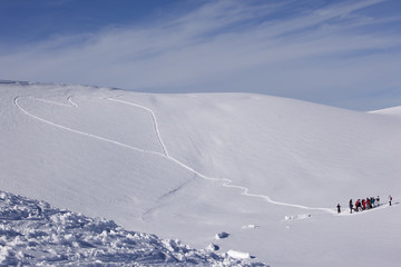 Heart shaped trails in a snow slope