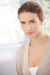 Portrait of beautiful woman in beige