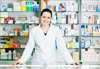 Photo sur Toile Pharmacie Pharmacy chemist woman in drugstore