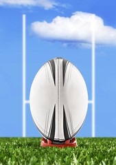 Wall Mural - Rugby ball ready to be kicked over the goal posts
