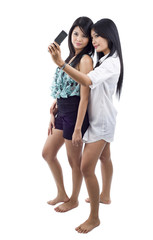 two asian women with mobile phone