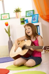 Portrait of schoolgirl with guitar