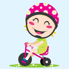 Sweet little girl driving a tricycle with safety helmet