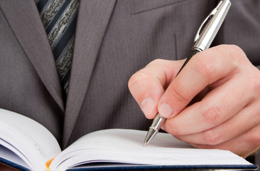 Sticker - Businessman writing in business diary