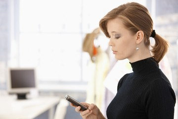 Attractive woman using mobile