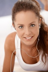 Portrait of attractive girl using headset smiling