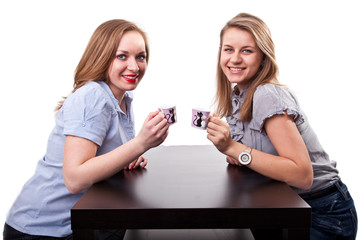 Two  beautiful ladys drinking tea and smiling
