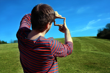 Man taking photo with his hands