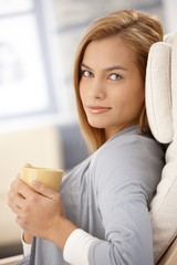 Portrait of smiling woman with coffee cup